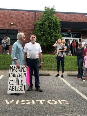 Critical race theory and anti-mask protesters gathered outside of the Buncombe County Board of Education building on June 3, 2021.