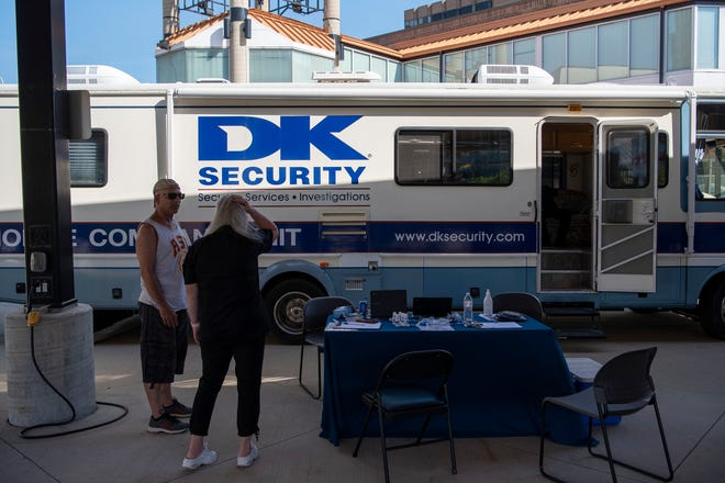 DK Security sets up as a vendor at Festival Market Square, hosting a job fair on Friday, June 4, 2021 in Battle Creek, Mich.
