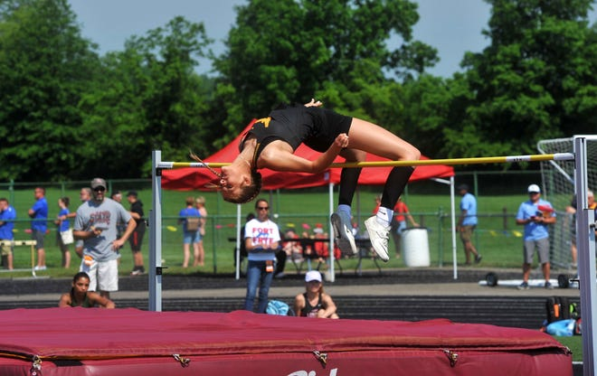Colonel Crawford's Liv Krassow soars over the bar in the Division III high jump state championship.