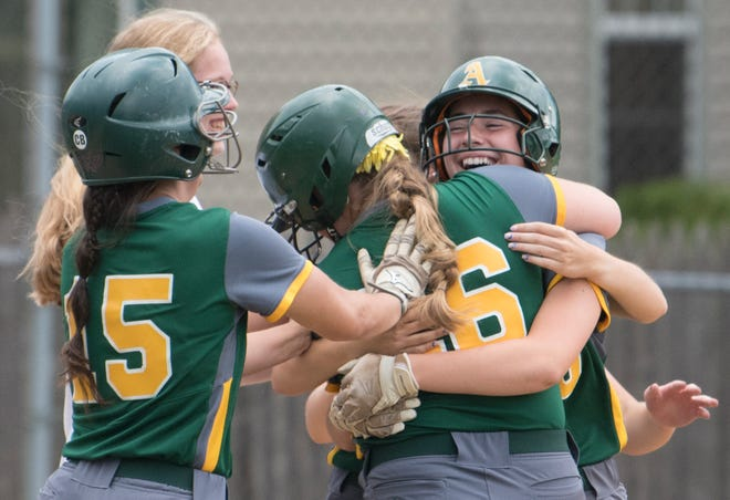 Audubon's Alex Holton, right, celebrates with teammates after Holton batted in the game-winning run during Audubon's 7-6 victory over West Deptford in the South Jersey Group 2 softball quarterfinal game played in Audubon on Friday, June 4, 2021.