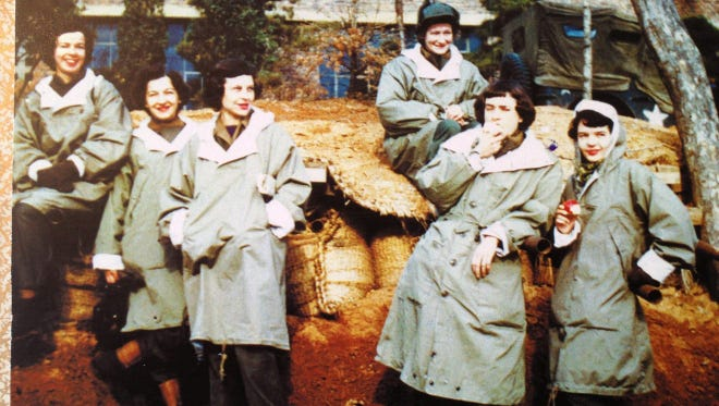 """Cathy Drake (top left) poses with friends and fellow nurses while serving as a nurse at a MASH unit near the 38th parallel. Drake, who along with her husband served as inspirations for the book, movie and television versions of """"M*A*S*H,"""" has died at 96."""