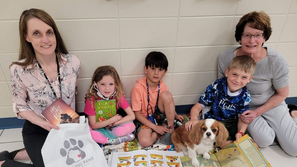 Healing Paws deliver books in lieu of reading dog visits