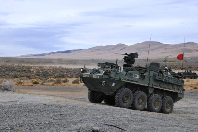 Oshkosh Corp. on Friday announced a $942.9 million contract to integrate a 30mm weapon system into the U.S. Army's Stryker troop transport trucks. In this photo, Cavalry troopers fired a Stryker-mounted .50-caliber machine gun as part of gunnery training at Yakima Training Center in Washington.