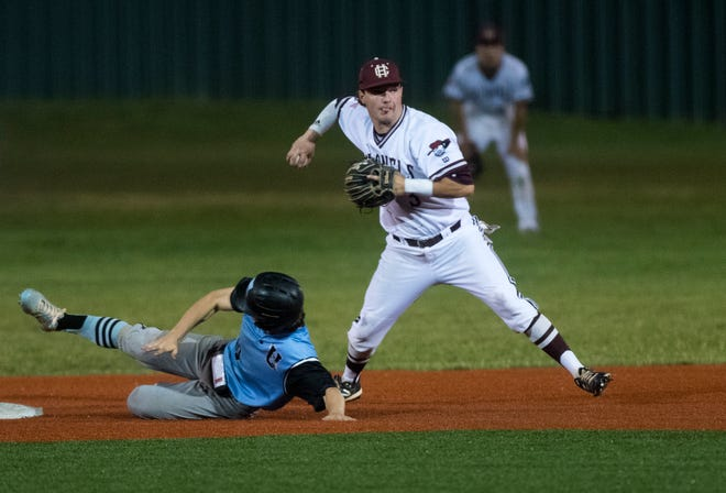 Henderson County's Colton Evans (3) throws to first after outing a runner as the Henderson County Colonels play the Union County Braves during the 2021 Sixth District baseball championship in Owensboro, Ky., Thursday evening, June 4, 2021.