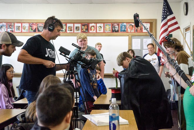 """Executive Producer Jason Campbell runs the camera during a talent show scene in which Rusty – actor Brendon Neuenschwander of Canton, Ohio – pulls a snake out of a hat prompting screams from his classmates, other actors and extras, while filming """"Halloween Heroes"""" at Holy Name of Jesus Catholic School in Henderson, Ky., Thursday afternoon, June 3, 2021. The family friendly Christian film is being created by JCFilms and Little Chicago Pictures, which will be filming in various locations around Henderson until June 9."""