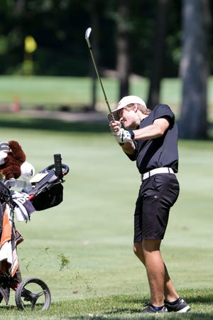 Faith's Joe Peter chips on hole no. 11 during the IHSAA boys golf sectional, Friday, June 4, 2021 in West Lafayette.