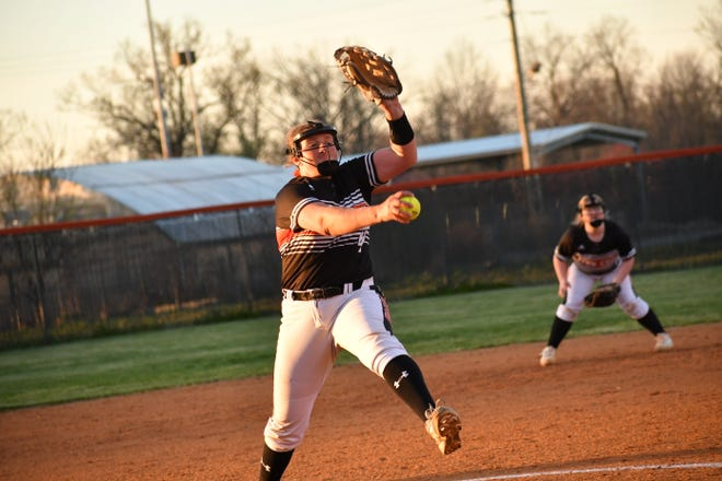 Fern Creek freshman pitcher Ally Richardson winds up to deliver her pitch