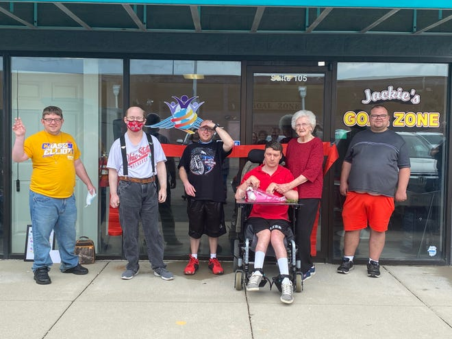 From left to right: Brandon Scott, Eric Craig, Varrick Glaze, Nate Osborn, Jackie Winchell and James Oakley at the grand opening of Jackie's Goal Zone Thursday, June 3, 2021. The center provides life skills and entertainment to people with disabilities.