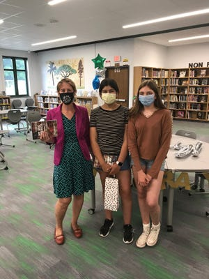 Greendale Middle School eighth grade social studies teacher Erin McCarthy (left) is pictured here with two of her students, Emilia Anders (middle) and Savannah Schindler (right).