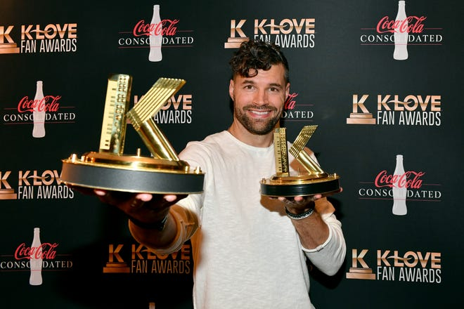Joel Smallbone of For King and Country holds their awards for artist of the year and duo of the year backstage during the 2021 K-LOVE Fan Awards on June 04, 2021 in Nashville, Tennessee.