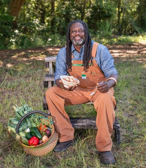 """Chef Matthew Riaford's first cookbook, """"Bress 'n' Nyam,"""" celebrates his Gullah-Geechee heritage. (Courtesy of The Countryman Press, a Division of W.W. Norton & Company)"""