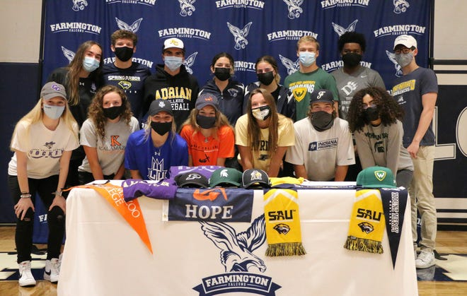 A group of Farmington senior athletes participate in the school's signing day ceremony.