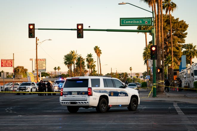 An off-duty Phoenix police officer directing traffic near 15th Avenue and Camelback Road on Thursday afternoon shot a man in the area police said was pointing a gun at two other people.
