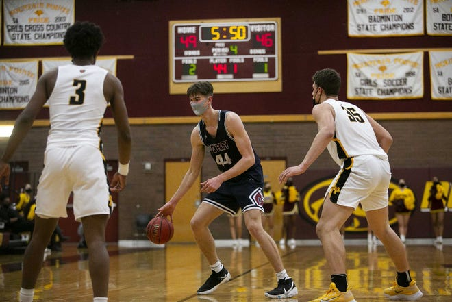 Feb. 16, 2021; Phoenix, AZ, USA; Perry's small foward Dylan Anderson (44) dribbles the ball down the court at Mountain Pointe High School on Feb. 16, 2021. Credit: Meg Potter/The Arizona Republic