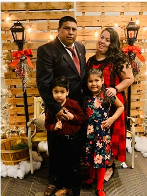 Marcelo Ticona is pictured with his wife and two children. Ticona sustained a spinal cord injury and is unable to move his legs after he hit his head in a swimming accident on May 10, 2021.