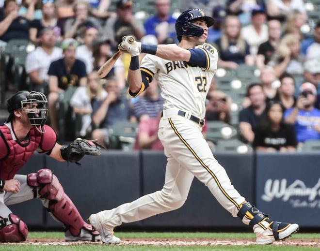 Christian Yelich hits a three-run homer in the third inning against the Arizona Diamondbacks at American Family Field on Thursday night.