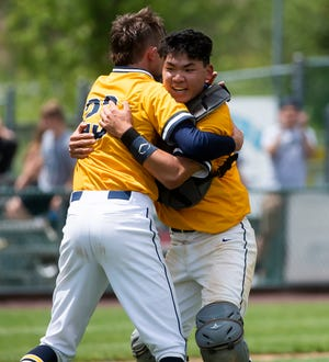 Elco catcher Jeremy Eck, right, hugs pitcher Dakota Smith after the Raiders recorded the final out to beat Wyomissing and win the PIAA District 3 Class 4A championship game at Earl Wenger Field in Fredericksburg on Friday, June 4, 2021. The Raiders won, 10-0, in five innings. Best friends since the age of 4, Eck and Smith are hoping to also lead Elco on  a state playoff run, beginning on Monday,