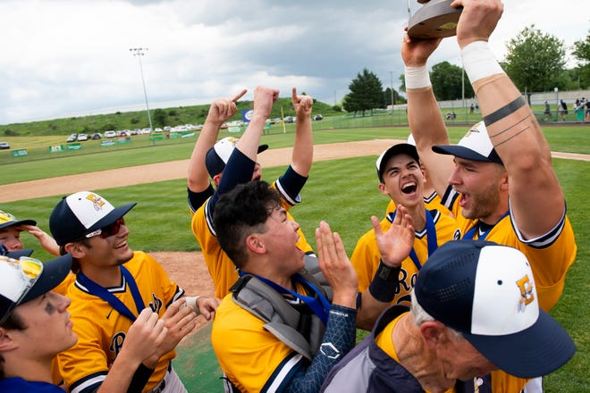The Elco Raiders celebrate with their championship trophy after winning the PIAA District 3 Class 4A championship game against Wyomissing at Earl Wenger Field in Fredericksburg on Friday, June 4, 2021. The Raiders won, 10-0, in five innings.
