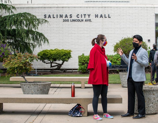 Monterey County for District 4 Supervisor, Wendy Root Askew, talks with Salinas Councilmember Anthony Rocha  outside city hall in Salinas, Calif., on Friday, June 4, 2021.