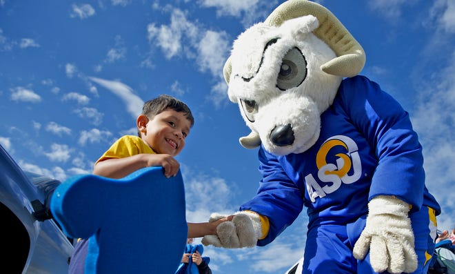 Lane Guadarrama, left, shakes hands with the Angelo State University mascot during a send-off event for the ASU baseball team who were on their way to compete in the Division II NCAA College World Series on Thursday, June 3, 2021.