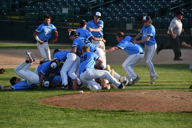 Dell Rapids players celebrate after winning the Class B state baseball title at Sioux Falls Stadium on Tuesday, June 1, 2021.