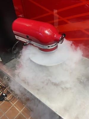 Nitrogen smoke overflows from a mixer used to make nitrogen ice cream at Sub Zero Nitro.