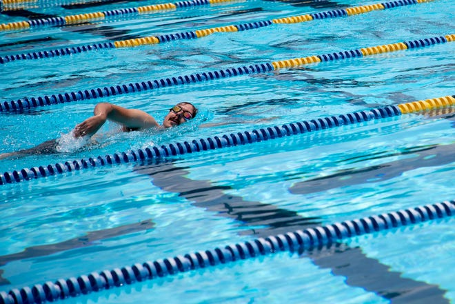 A swimmer does laps at Trousdell Aquatics Center Thursday, June 3, 2021.