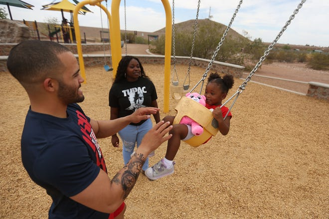 Antonio Serrano pushes his daughter Amira on the swing with Amira's mom, Nerlinne Artus, on Friday at the Westside Community Rec Center & Dog Park in El Paso. The family was out enjoying the overcast day before a string of 100-degree days is expected to start Sunday in El Paso.