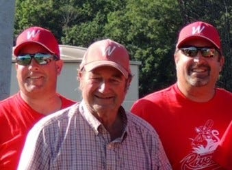 Ron Carpenter, center, started the Wisconsin River Rats traveling youth baseball team decades ago, and has been a coach, and most recently a general manager. He's flanked her in this 2014 file photo by coaches Tim Kimball (left) and Scott Schubring (right)
