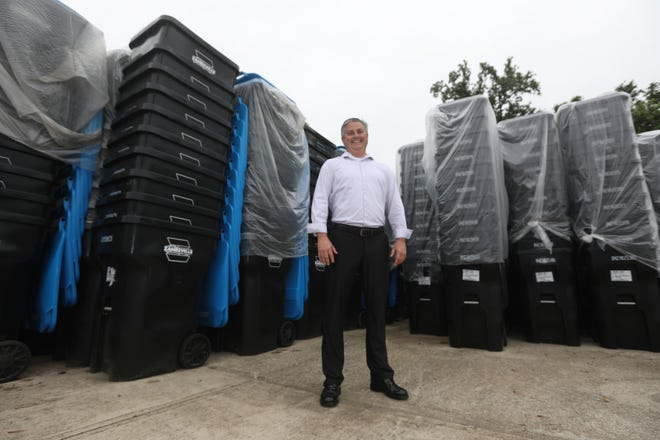 Zanesville Public Service Director Scott Brown with the city's collection of recycling totes awaiting new homes.