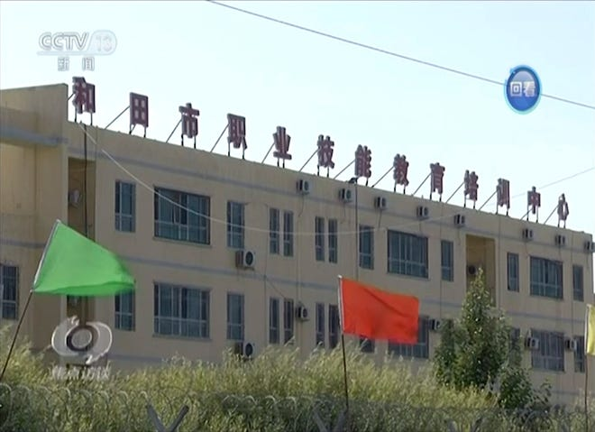 In this image from undated video footage run by China's CCTV via AP Video, the exterior of Hotan Vocational Education and Training Center sits behind razor wire in Hotan, Xinjiang, northwest China.