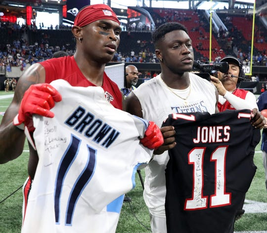 Might Julio Jones, left, be joining fellow WR A.J. Brown in a Titans jersey?