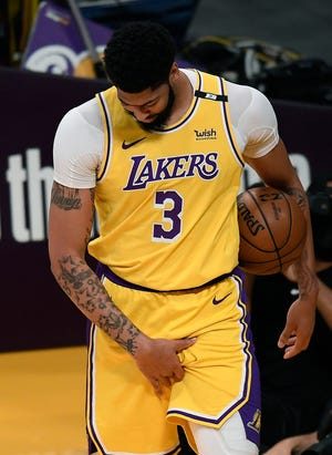 Anthony Davis grabs his injured left groin during the opening minutes of the Lakers' Game 6 loss to the Suns.