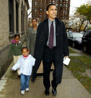 Barack Obama, then a candidate for the Illinois Democratic Senate, leaves with his wife Michelle, daughters Sasha, front left, and Malia after voting at the Catholic Theological Union polling station in Chicago on November 2, 2004 .