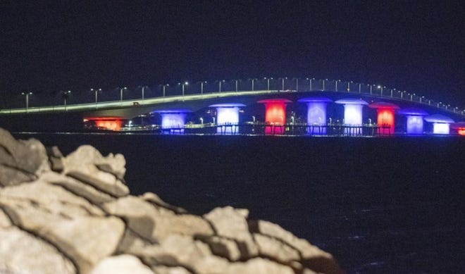 The John Ringling Causeway Bridge glows in red, white and blue to honor COVID-19 patients at Sarasota Memorial Hospital. FDOT approved the city lighting request last year.