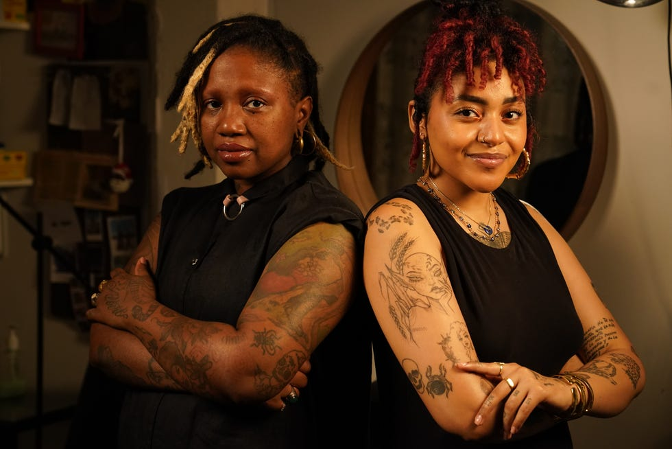 Tann Parker (left), founder of Ink the Diaspora, and tattoo artist Quiara Capellan stand in their studio in Brooklyn, NY.