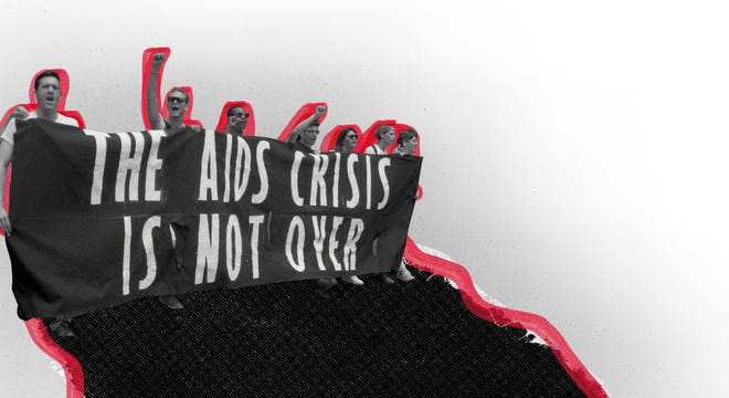 """Marchers during the 1990 Gay Pride Parade hold a banner that reads """"The AIDS crisis is not over."""""""
