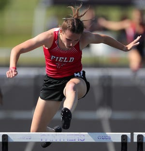 Field's Hannah Siudak clears the final hurdle in the girls 300 meter hurdles event during the Division II OHSAA State Track and Field Tournament at Pickerington High School North on Friday.