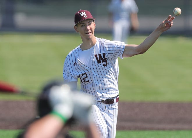 Walsh Jesuit's Erik Stern throws a pitch against Mayfield during the Warriors' 7-0 win in a Division I regional final Saturday in Louisville [Phil Masturzo/Beacon Journal]