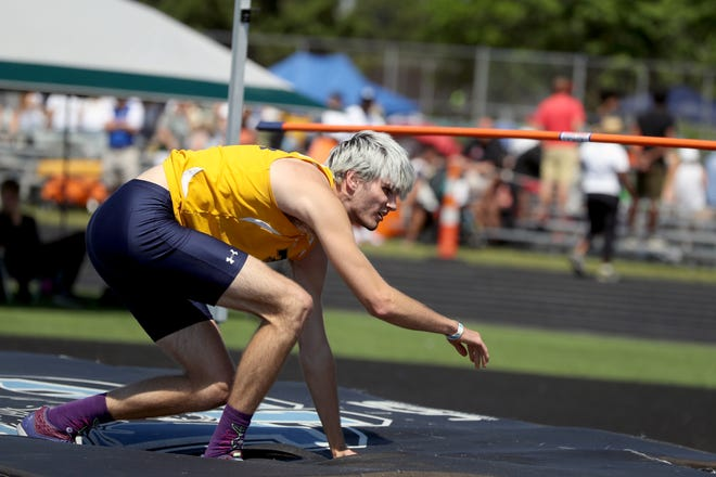 The bar falls just after Tallmadge's Riley Murphy rises from his third attempt at 6 feet 6 inches in the high jump during the Division I State Track and Field Tournament on June 5, 2021, at Hilliard Darby High School in Hilliard, Ohio.
