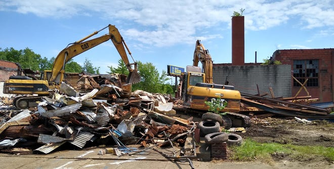 Heavy equipment tears apart the former loading dock of the Galat Packing Co. on Friday afternoon at 1472 Kenmore Blvd. in Akron.