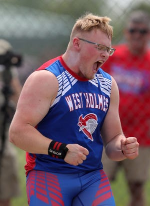 West Holmes' Lane Graham celebrates after winning the boys shot put event during the Division II OHSAA State Track and Field Tournament at Pickerington High School North on Friday.
