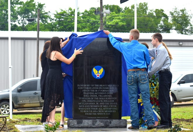 Members of the MIll Creek schools class of 2025 unveil a memorial to victims of a 1944 training accident Saturday, June 5, 2021.