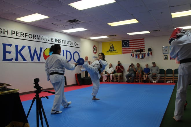 Instructor Jean Gamarra and his daughter Liesel give a demonstration at the grand opening of the High Performance Institute of Taekwondo.