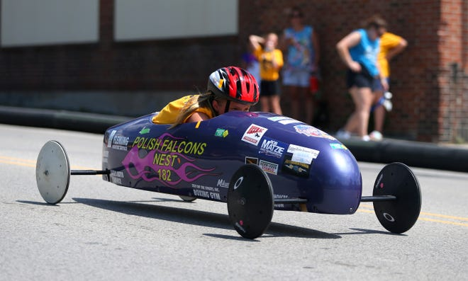 Young Racer Allison Ramaley pulls ahead while racing in the super stock class during the 20th Annual Western Pennsylvania Soap Box Derby Saturday morning in Ambridge.