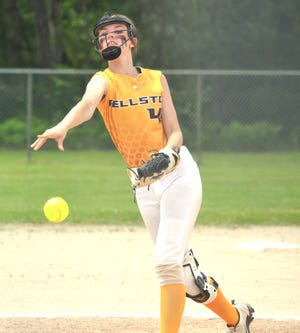 Pellston junior Madison Brown fires a pitch during a Division 4 district softball final against St. Ignace in Pellston on Saturday.