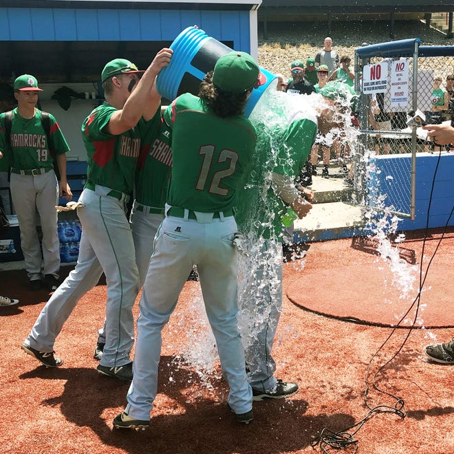 Barnesville head coach D.J. Butler gets a Gatorade bath following his team's 10-7 win against Minford in a Division III regional final on Saturday at Beavers Field in Lancaster.