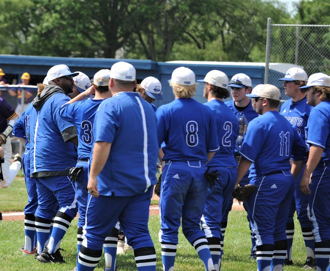Cambridge coach Jamaal Lowery talks to his team before the seventh inning in Friday's 3-2 loss to Bloom-Carroll in the Division II baseball regional semifinal at Teays Valley.
