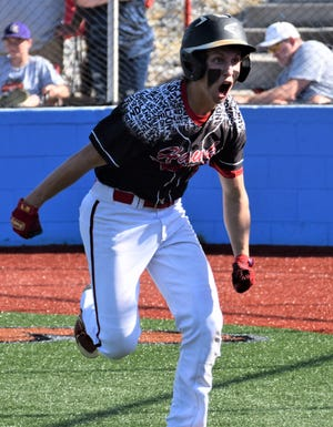 Hiland sophomore Isaak Yoder reacts after launching a two-run homer to give the Hawks a 7-0 lead over East Knox. Yoder homered and doubled in the Hawks 8-0 triumph in the Div. IV Lancaster Regional semifinal.