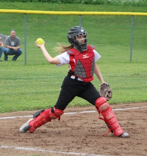 Canisteo-Greenwood's Savannah Ambuski fields and fires to first for the out on Friday evening in Arkport.